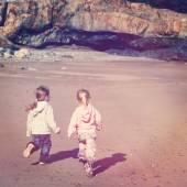 Little girls run on beach — Stock Photo