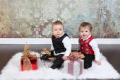 Little boys with gift boxes — Stock Photo