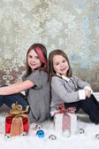 Little girls with gift boxes — Stock Photo