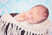 Baby boy sleeping in basket — Stock Photo