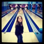 Little Girl smiling at bowling lane — Stock Photo
