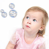 Little girl looking at balls — Stock Photo