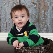 Little Boy in basket — Stock Photo