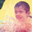 Boy closeup on water slide — Stock Photo #53164513