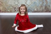 Little girl in  Christmas dress — Стоковое фото
