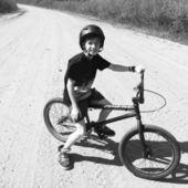Boy on bike posing outdoors — Foto Stock