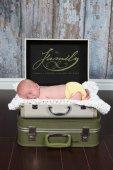 Newborn Baby boy lying in suitecase — Stock Photo