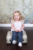 Little Girl Sitting on Suitcase — Stock Photo