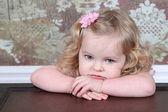 Little Girl Sitting on Suitcase — Stock Photo