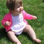 Little girl sitting on grass — Stock Photo #53352937