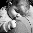 Little Baby girl sleeping in mothers arms — Stock Photo #53353953