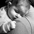 Little Baby girl sleeping in mothers arms — Stock Photo #53353955