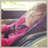 Sweet baby girl sleeping in car seat — Stock Photo