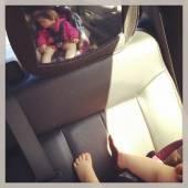 Sweet baby girl sleeping in car seat — Stock Photo