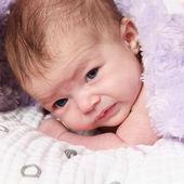 Newborn baby girl lying on blanket — Stock Photo