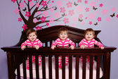 Baby Triplets in Crib — Stock Photo