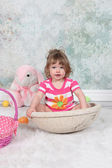 Beautiful Little Girl sitting in basket — Foto Stock