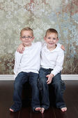 Little boys sitting in old empty room — Stock Photo