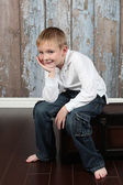 Little boy posing in old empty room — Стоковое фото