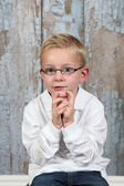 Little boy posing in old empty room — Stock Photo