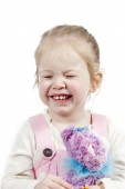 Adorable little girl with toy — Stock Photo