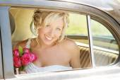 Bride in Car on wedding day — Stock Photo