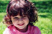 Little girl looking away outside — Stock Photo
