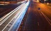 Blur cars driving at night — Stock Photo