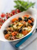 Squid with tomatoes olives and capers, selective focus — Stock Photo