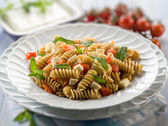 Pasta with feta cheese fresh tomatoes and mint leaf, selective f — Stock Photo