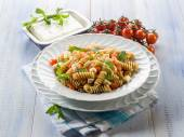 Pasta with feta cheese fresh tomatoes and mint leaf — Stock Photo