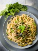 Spaghetti with anchovies parsley and capers — Stock Photo