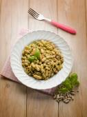Pasta with pesto and beans — Stock Photo