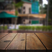 Wooden table in garden for product display montage — Stock Photo