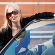 Happy young fashion woman at the convertible car — Stock Photo #52251495