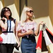 Two happy young fashion women with shopping bags — Stock Photo #52251525
