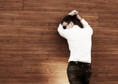 Young business man in depression at the wall — Stock Photo