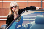 Happy young fashion woman at the convertible car — Foto de Stock
