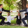 Young business people in a city park — Stock Photo #52779509