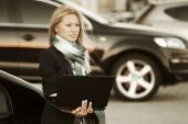 Fashion business woman with laptop at the car — Foto de Stock