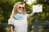 Young fashion woman taking a selfie with tablet computer — Stock Photo