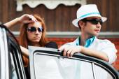 Young fashion couple in love at the retro car — Stock Photo