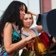 Two young fashion women with shopping bags at the car trunk — Stock Photo #58163767