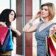Two young fashion women with shopping bags — Stock Photo #58163779