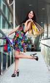 Young fashion woman with shopping bags — Stock Photo