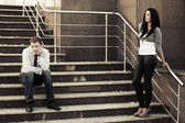 Young fashion couple in conflict on the steps — Stock Photo