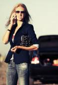 Young fashion woman with broken car calling on the cell phone  — Stock Photo