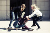 Group of teenage girls with skateboard — Stock Photo
