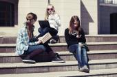Teenage school girls on the steps of campus — Stock Photo