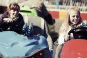 Happy teenage girls driving a bumper cars — Stock Photo